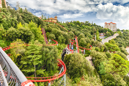 BARCELONA - AUGUST 12: Rollercoaster attraction of Tibidabo Amusement Park, Barcelona, Catalonia, Spain on August 12, 2017. The park opened in 1905 is among the oldest in the world still functioning