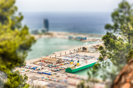 Aerial view over the commercial and industrial Port of Barcelona, Catalonia, Spain. Tilt-shift effect applied