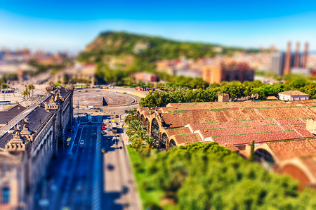 Scenic aerial view with Montjuic mountain in background from the top of Columbus Monument, Barcelona, Catalonia, Spain. Tilt-shift effect applied Stock Photo