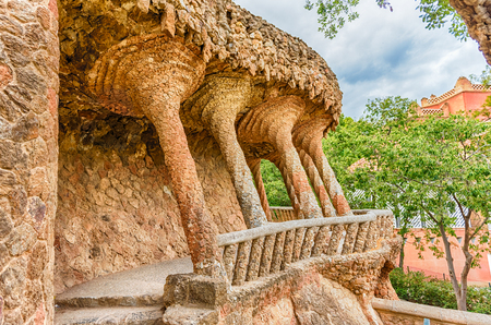 colonnaded: Colonnaded roadway viaduct made with masonry arcades in Park Guell, Barcelona, Catalonia, Spain Editorial
