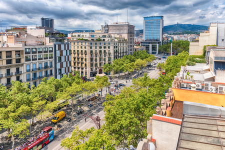 BARCELONA - AUGUST 9: Aerial view of Passeig de Gracia from Casa Mila, aka La Pedrera, in the Eixample district of Barcelona, Catalonia, Spain, on August 9, 2017