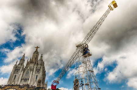 BARCELONA - AUGUST 12: Tibidabo Amusement Park and Church of the Sacred Heart, Barcelona, Catalonia, Spain on August 12, 2017. The park is among the oldest in the world still functioning