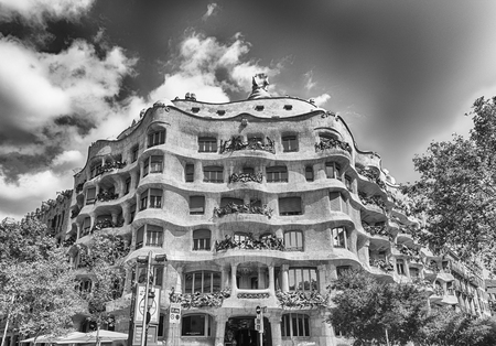 decorative balcony: BARCELONA - AUGUST 9: Facade of the modernist masterpiece Casa Mila, aka La Pedrera, renowned building designed by Antoni Gaudi and iconic landmark in Barcelona, Catalonia, Spain, on August 9, 2017