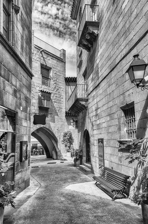 Scenic alley inside Poble Espanyol, an open-air architectural museum on the Montjuic hill in Barcelona, Catalonia, Spain Banque d'images