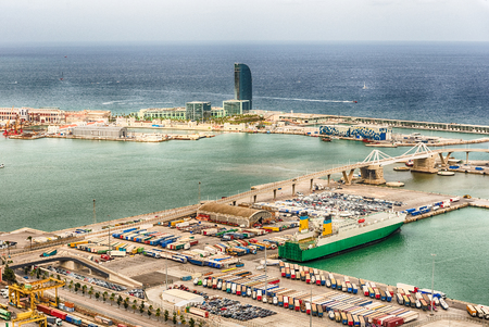Aerial view over the commercial and industrial Port of Barcelona, Catalonia, Spain