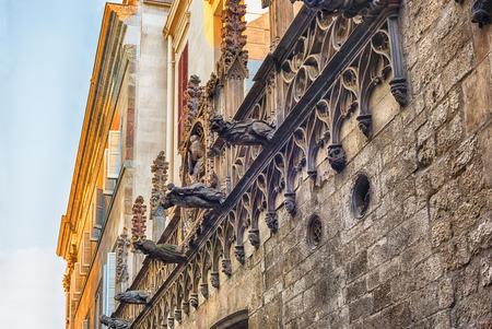 Gargoyles in Carrer del Bisbe, scenic street in the Gothic Quarter of Barcelona, Catalonia, Spain