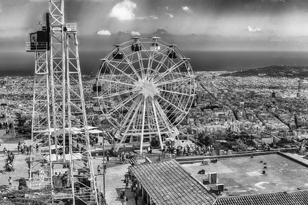 BARCELONA - AUGUST 12: Scenic view over the Tibidabo Amusement Park, Barcelona, Catalonia, Spain on August 12, 2017. The park opened in 1905 and is among the oldest in the world still functioning
