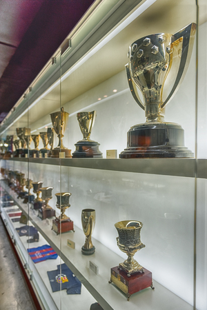 BARCELONA - AUGUST 11: Trophy case of FC Barcelona at Camp Nou Museum, Barcelona, Catalonia, Spain, on August 11, 2017. The museum occupies 3,500 square meters and attracts 1.2 million visitors a year