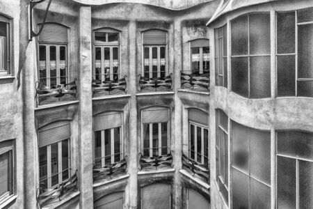 BARCELONA - AUGUST 9: Windows in the inner courtyard of Casa Mila, aka La Pedrera, renowned building designed by Antoni Gaudi and iconic landmark in Barcelona, Catalonia, Spain, on August 9, 2017 Éditoriale