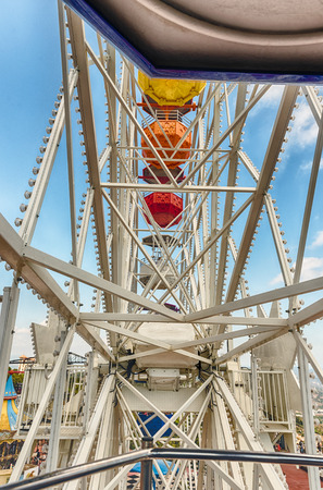 BARCELONA - AUGUST 12: Vintage ferris wheel attraction at Tibidabo Amusement Park, Barcelona, Catalonia, Spain on August 12, 2017. The park is among the oldest in the world still functioning