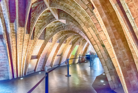 BARCELONA - AUGUST 9: Catenary arcs in the penthouse of Casa Mila, aka La Pedrera, renowned building designed by Antoni Gaudi and iconic landmark in Barcelona, Catalonia, Spain, on August 9, 2017