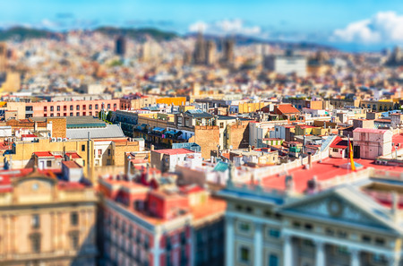 Scenic aerial view of the Gothic Quarter from the top of Columbus Monument, Barcelona, Catalonia, Spain. Tilt-shift effect applied Stock Photo