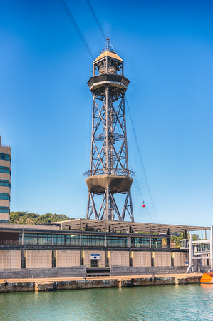 View of Jaume I tower, one of the two stations of Port Vell Aerial Tramway, iconic landmark of Barcelona, Catalonia, Spain