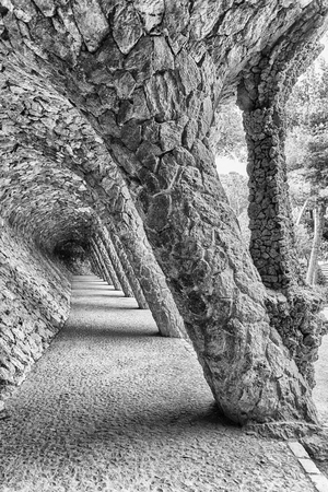 Colonnaded pathway made with masonry arcades in Park Guell, Barcelona, Catalonia, Spain