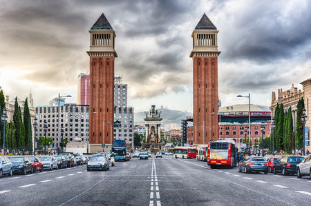 Venetian Towers on Avinguda de la Reina Maria Christina, Barcelona, Catalonia, Spain. Built between 1927 and 1929, the towers are modeled on Bell Tower of St. Mark Basilica in Venice