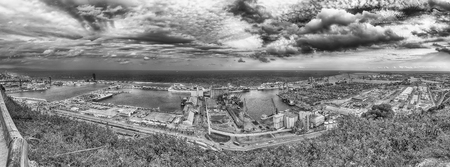 Panoramic aerial view over the commercial and industrial Port of Barcelona from Montjuic hill, Catalonia, Spain