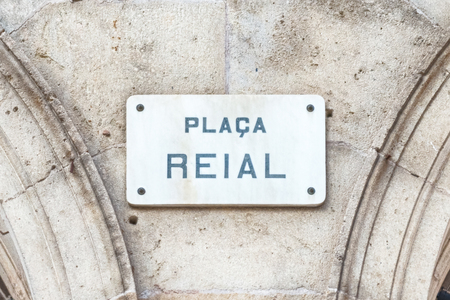 Street sign for Placa Reial, sightseeing and iconic square of the Gothic Quarter in Barcelona, Catalonia, Spain