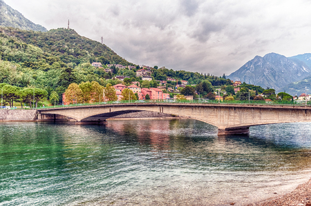 View over John Fitzgerald Kennedy Bridge, aka New Bridge, on the river Adda in the city of Lecco, Italy