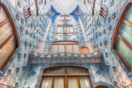 BARCELONA - AUGUST 9: Iconic blue lightwell inside Casa Batllo, renowned building designed by Antoni Gaudi and iconic landmark in Barcelona, Catalonia, Spain, on August 9, 2017