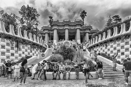 BARCELONA - AUGUST 9: Main entrance and staircase of Park Guell in Barcelona, Catalonia, Spain, on August 9, 2017. Designed by Antoni Gaudi, the park opened in 1926