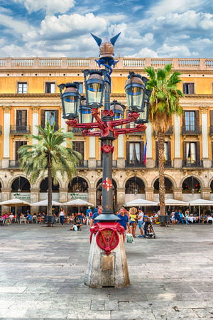 BARCELONA - AUGUST 8: Lantern designed by Antoni Gaudi in Placa Reial, scenic sightseeing and iconic square of the Gothic Quarter in Barcelona, Catalonia, Spain, on August 8, 2017