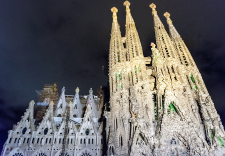 BARCELONA - AUGUST 9: Night view of Nativity Facade of Sagrada Familia, iconic landmark designed by Antoni Gaudi in Barcelona, Catalonia, Spain, as seen on August 9, 2017. Cranes digitally removed Editorial