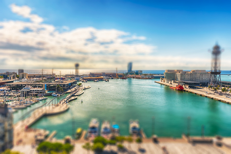 Scenic aerial view of Port Vell from the top of Columbus Monument, Barcelona, Catalonia, Spain. Tilt-shift effect applied