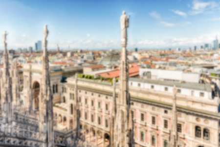 Defocused background with scenic aerial view over the city centre, as seen from the roof of the gothic Cathedral, Milan, Italy. Intentionally blurred post production for bokeh effect