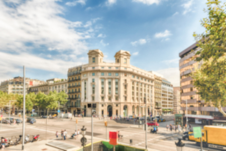 Defocused background with view of Passeig de Gracia in the Eixample district of Barcelona, Catalonia, Spain. Intentionally blurred post production for bokeh effect Éditoriale