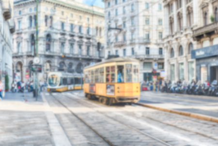 Defocused background with iconic trams operating in the city centre of Milan, Italy. Intentionally blurred post production for bokeh effect