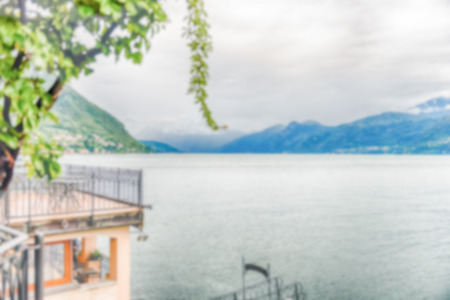 Defocused background with scenic idillic view over the Lake Como from the town of Varenna, Italy. Intentionally blurred post production for bokeh effect