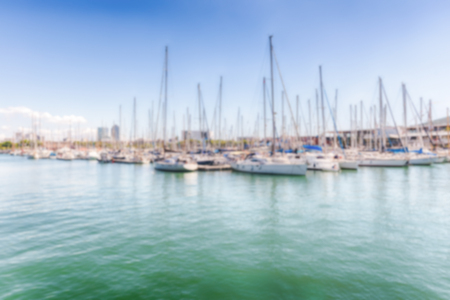 Defocused background with sailboats in Port Vell, Barcelona, Catalonia, Spain. Intentionally blurred post production for bokeh effect