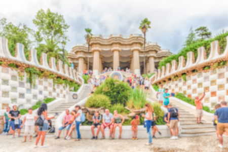 Defocused background with main entrance and staircase of Park Guell, Barcelona, Catalonia, Spain. Intentionally blurred post production for bokeh effect Banque d'images