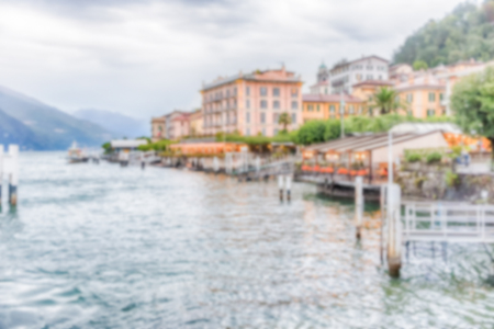 Defocused background with scenic view at dusk with waterfront of Bellagio town on the Lake Como, Italy. Intentionally blurred post production for bokeh effect Banque d'images