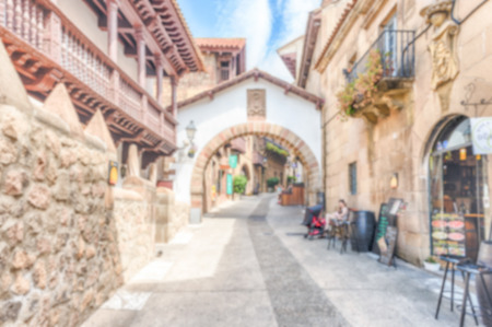 Defocused background of Poble Espanyol, an open-air architectural museum on the Montjuic hill in Barcelona, Catalonia, Spain. Intentionally blurred post production for bokeh effect