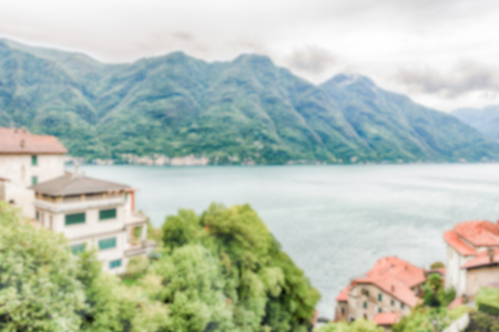 Defocused background with scenic landscape over the Lake Como, as seen from the town of Bellano, Italy. Intentionally blurred post production for bokeh effect