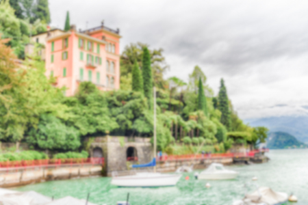 Defocused background of the picturesque village of Varenna over the Lake Como, Italy. Intentionally blurred post production for bokeh effect