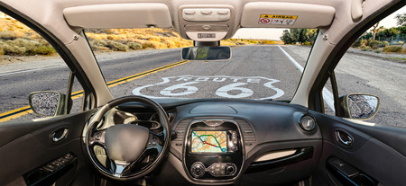 Looking through a car windshield with view over the Historic Route 66 and pavement sign in California, USA