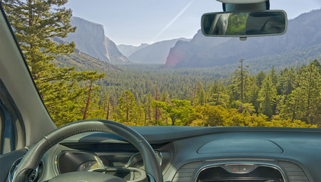 Looking through a car windshield with view of a beautiful green valley in Yosemite National Park, USA Stock fotó - 99433087