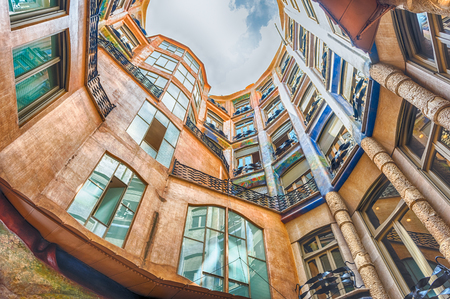 BARCELONA - AUGUST 9: View of the inner courtyard and atrium of Casa Mila, aka La Pedrera, renowned building designed by Antoni Gaudi and landmark in Barcelona, Catalonia, Spain, on August 9, 2017