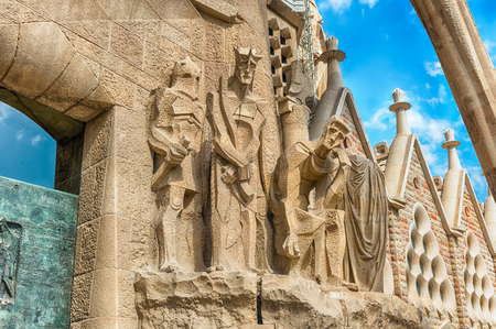 BARCELONA - AUGUST 9: Detail of the Passion Facade of the Sagrada Familia, the most iconic landmark designed by Antoni Gaudi in Barcelona, Catalonia, Spain, as seen on August 9, 2017