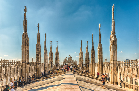 MILAN - SEPTEMBER 11: Tourists on the roof terrace of the gothic Cathedral, iconic landmark of Milan, Italy, September 11, 2017 Editorial