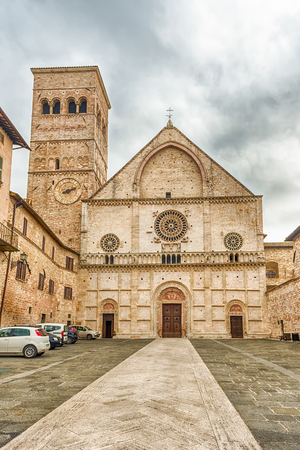 Exterior view with facade of the medieval Cathedral of Assisi, Italy. The church is dedicated to San Rufino