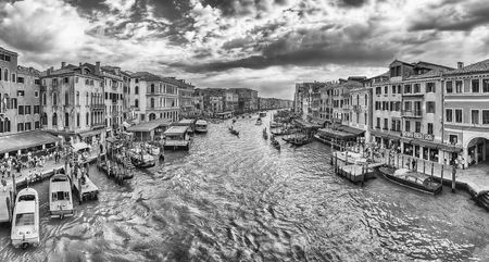 VENICE, ITALY - APRIL 29: Panoramic view of the Grand Canal at sunset from the iconic Rialto Bridge, one of the major landmark in Venice, Italy, as seen on April 29, 2018