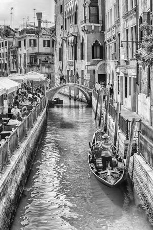 VENICE, ITALY - APRIL 29: Traditional Gondolas with scenic architecture along the canal Rio di S. Provoio, in Castello district of Venice, Italy, April 29, 2018 Editorial