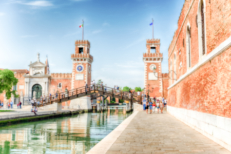 Defocused background with entrance to the Venetian Arsenal, Venice, Italy. Intentionally blurred for bokeh effect 스톡 콘텐츠