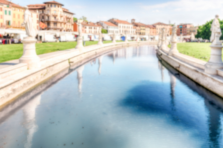 Defocused background with view of the scenic square of Prato della Valle and its beautiful canal in Padua. Intentionally blurred for bokeh effect