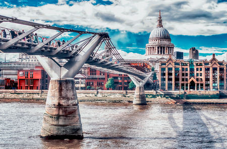 The Millennium Bridge with St. Paul's Cathedral in the background, London, UK