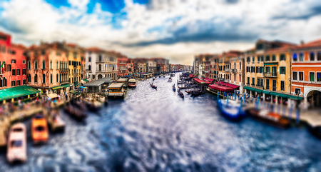 Panoramic view of the Grand Canal at sunset from the iconic Rialto Bridge, one of the major landmark in Venice, Italy. Tilt-shift effect applied