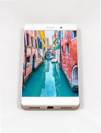 Modern smartphone with full screen picture of Venice, Italy. Concept for travel smartphone photography. All images in this composition are made by me and separately available on my portfolio